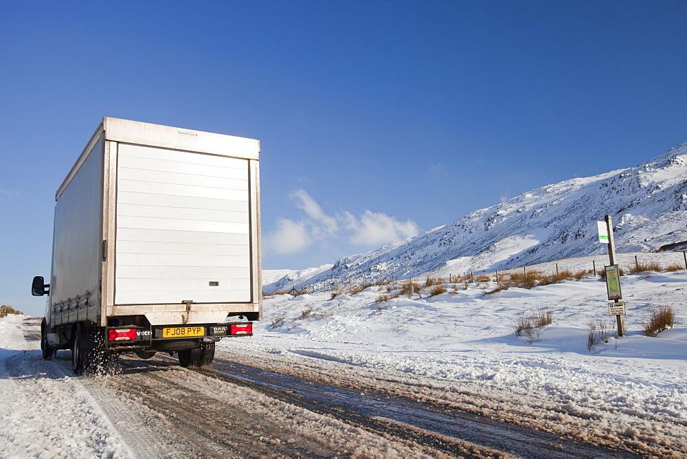 A vehicle on Kirkstone Pass in winter, Lake District, Cumbria, England, United Kingdom, Europe