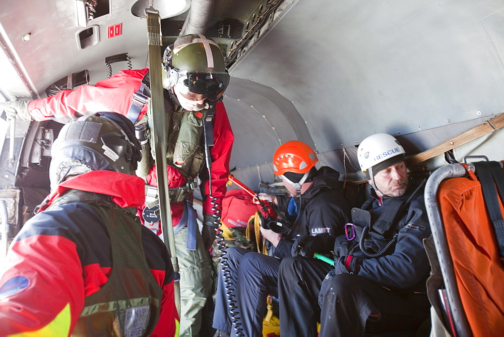 A Navy Sea King helicopter crew help to evacuate an injured walker in the Lake District, Cumbria, England, United Kingdom, Europe