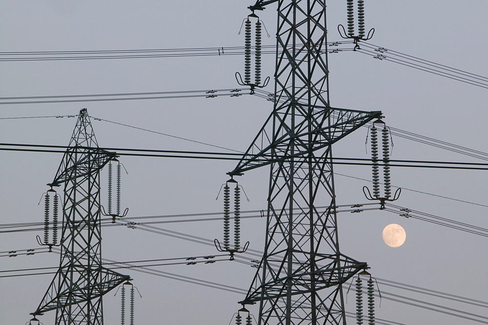A full moon and electricity pylons in Leicestershire, England, United Kingdom, Europe