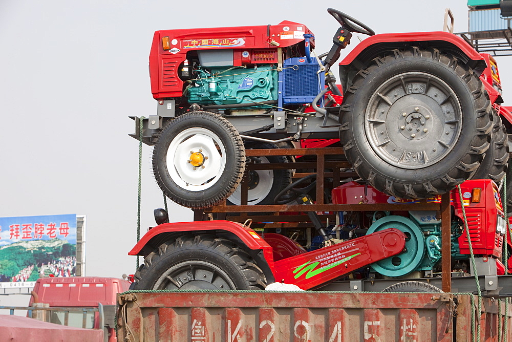 A lorry loaded with cheap new tractors in northern China, Asia