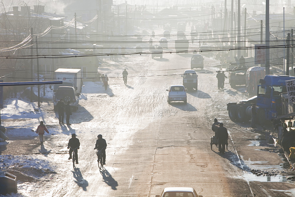 Slum dwellings in Suihua, Heilongjiang Province pump out coal smoke into an already highly polluted atmosphere, China, Asia