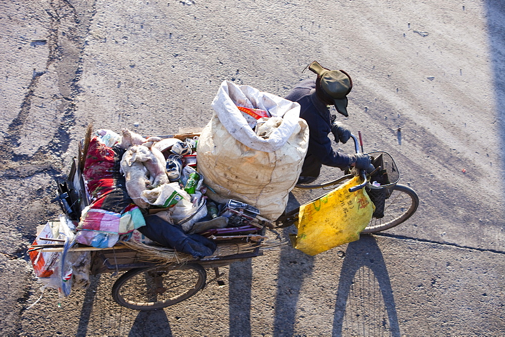 A Chinese peasant recycling rubbish on the streets of Suihua in Heilongjiang Province, Northern China, Asia