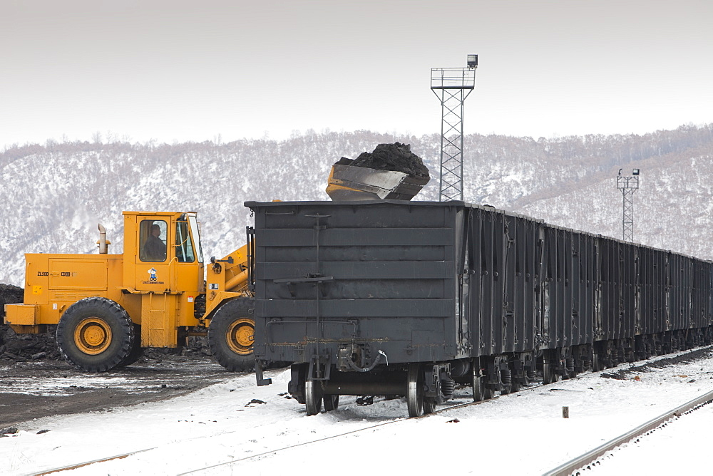 A train being loaded with low grade coal from an opencast coal mine near Heihe on the Chinese Russian border, Heilongjiang province, China, Asia