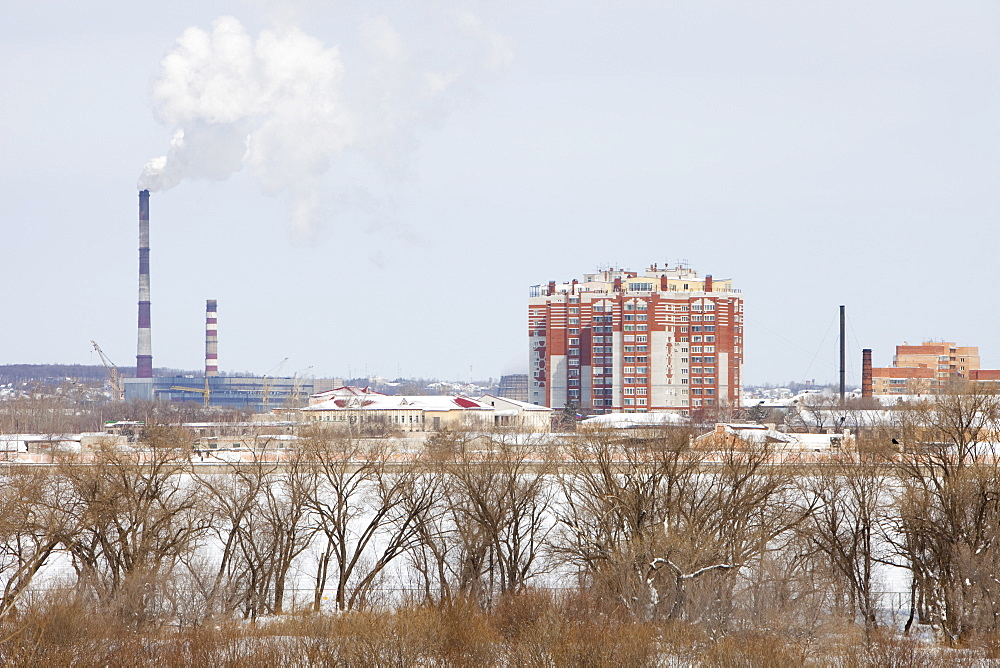 A coal fired power station in Russia taken across the Heilongjiang River that is the border between the Chinese city of Heihe and Russia, Heilongjiang, China, Asia