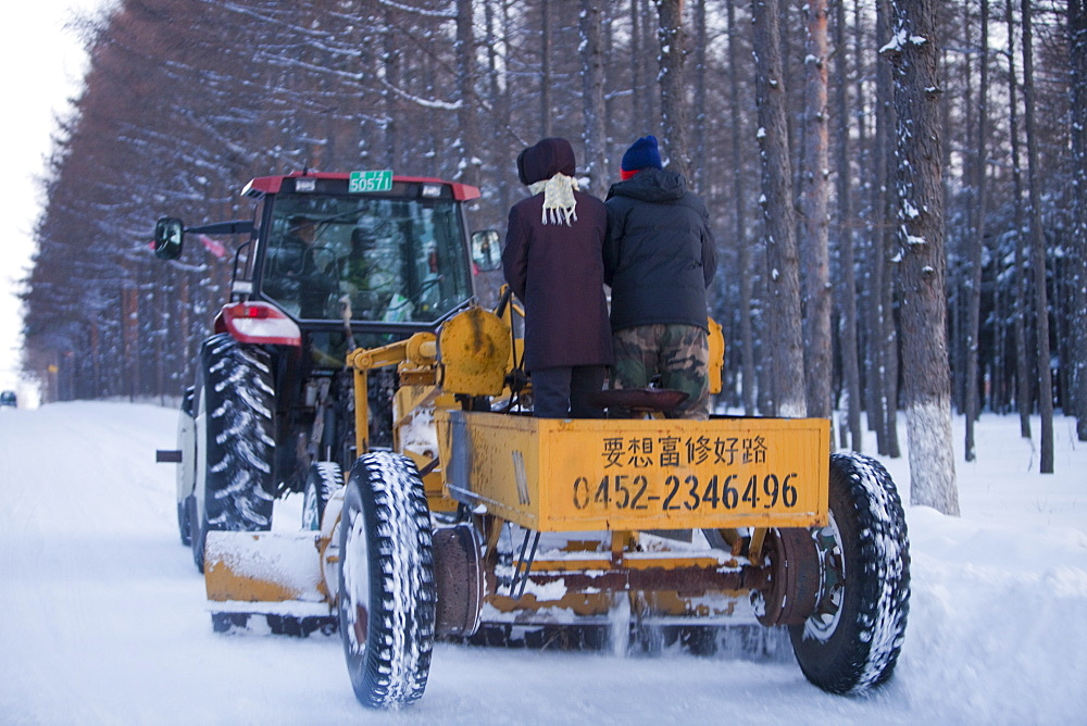 A snow plough clears the roads near Heihe after a very heavy snowfall in 2009, Heilongjiang, China, Asia