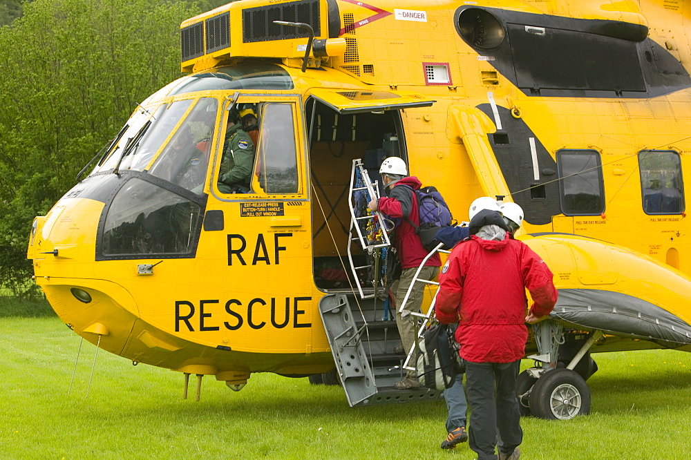 Members of a mountain rescue team board an RAF Sea King Helicopter, Lake District, Cumbria, England, United Kingdom, Europe