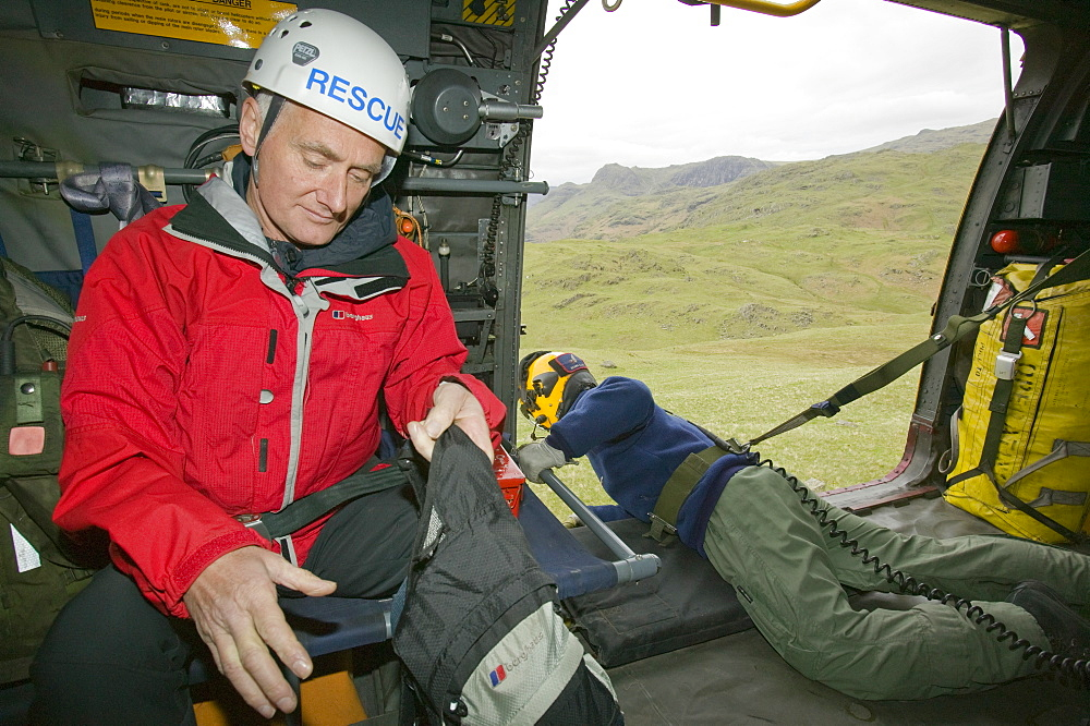 Members of a mountain rescue team onboard an RAF Sea King Helicopter, Lake District, Cumbria, England, United Kingdom, Europe