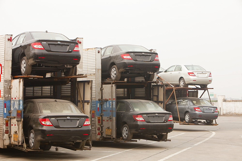 Car transporters loaded with new cars fuel China's ever increasing demand for vehicles, China, Asia