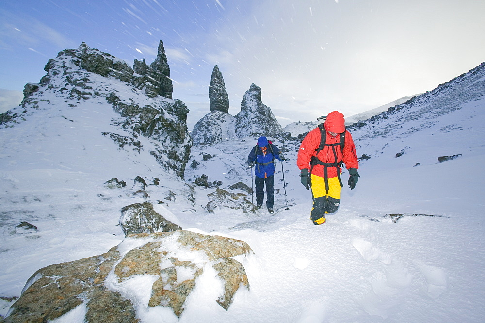Hikers in a blizzard near the Old Man of Storr on the Isle of Skye, Scotland, United Kingdom, Europe