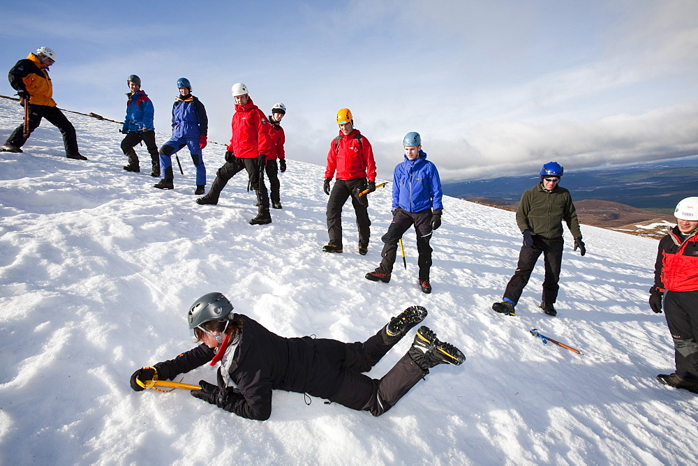 A group of mountaineers practise ice axe arrests on Cairngorm in the Cairngorm National Park in Scotland, United Kingdom, Europe