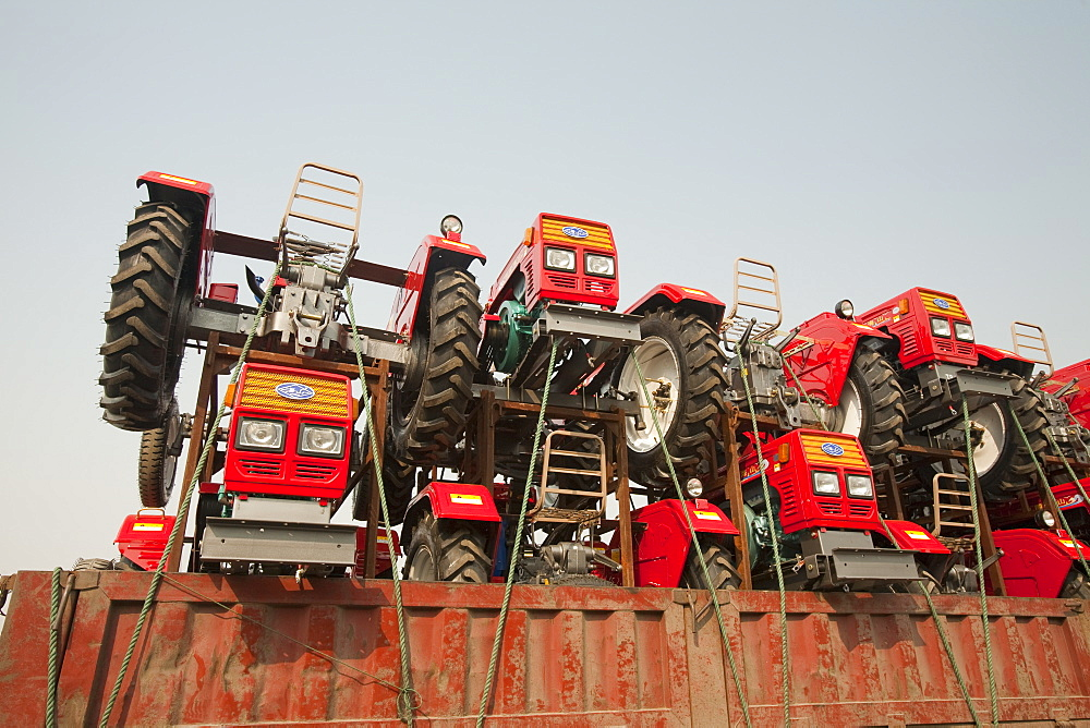 A lorry loaded with cheap new tractors in Heilongjiang, northern China, Asia