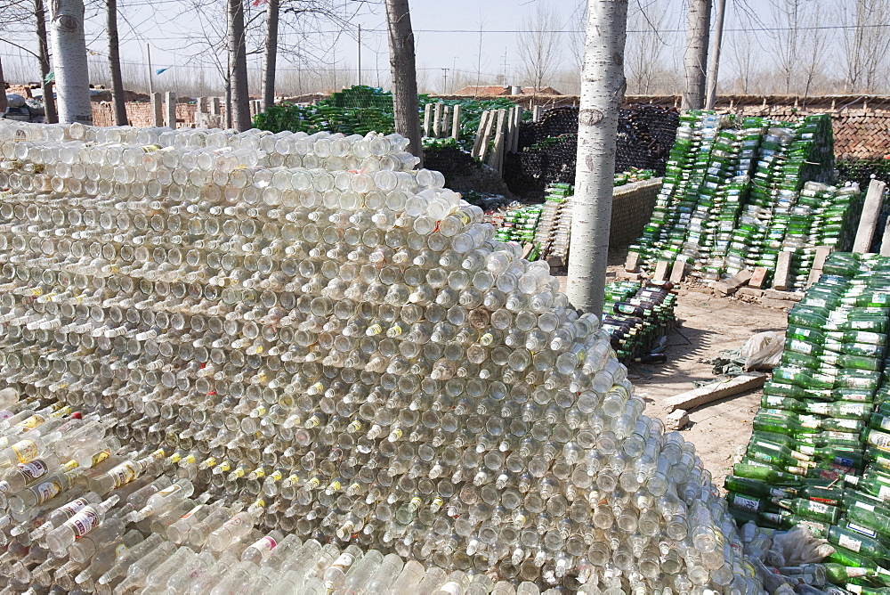 A family near Xian city make their living from recycling bottles and plastic, China, Asia