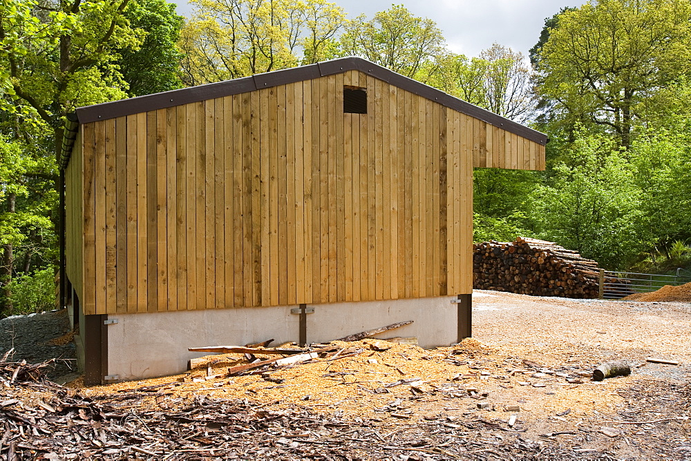 The woodchip store for a biofuel boiler in the grounds of the Langdale Timeshare in the Lake District, Cumbria, England, United Kingdom, Europe