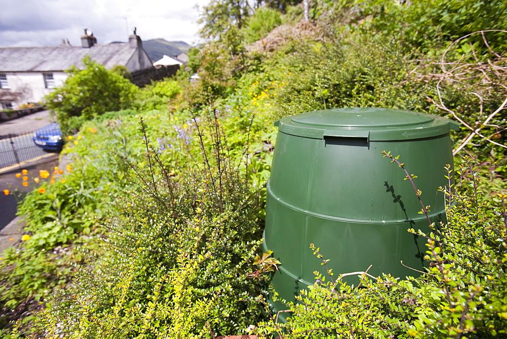 A compost bin in a garden in Ambleside, Lake District, Cumbria, England, United Kingdom, Europe