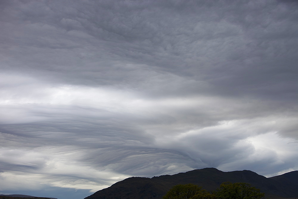 Patterns in cloud on an occluded front over the Lake District hills in Ambleside, Cumbria, England, United Kingdom, Europe