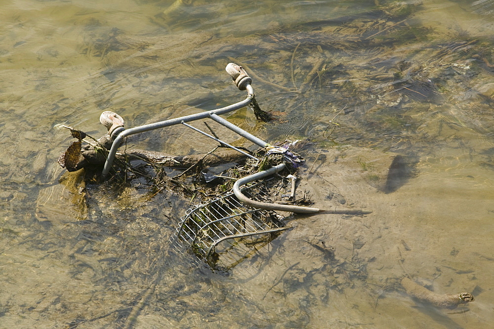 Supermarket trolley thrown into the River Taw in Barnstaple Devon, England, United Kingdom, Europe