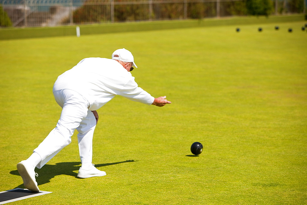 Man playing bowls at Penzance in West Cornwall, England, United Kingdom, Europe