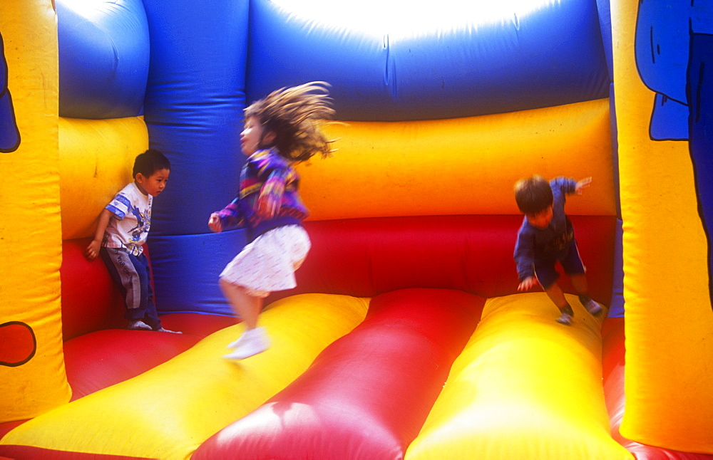 Children playing on a bouncy castle - 911-5149
