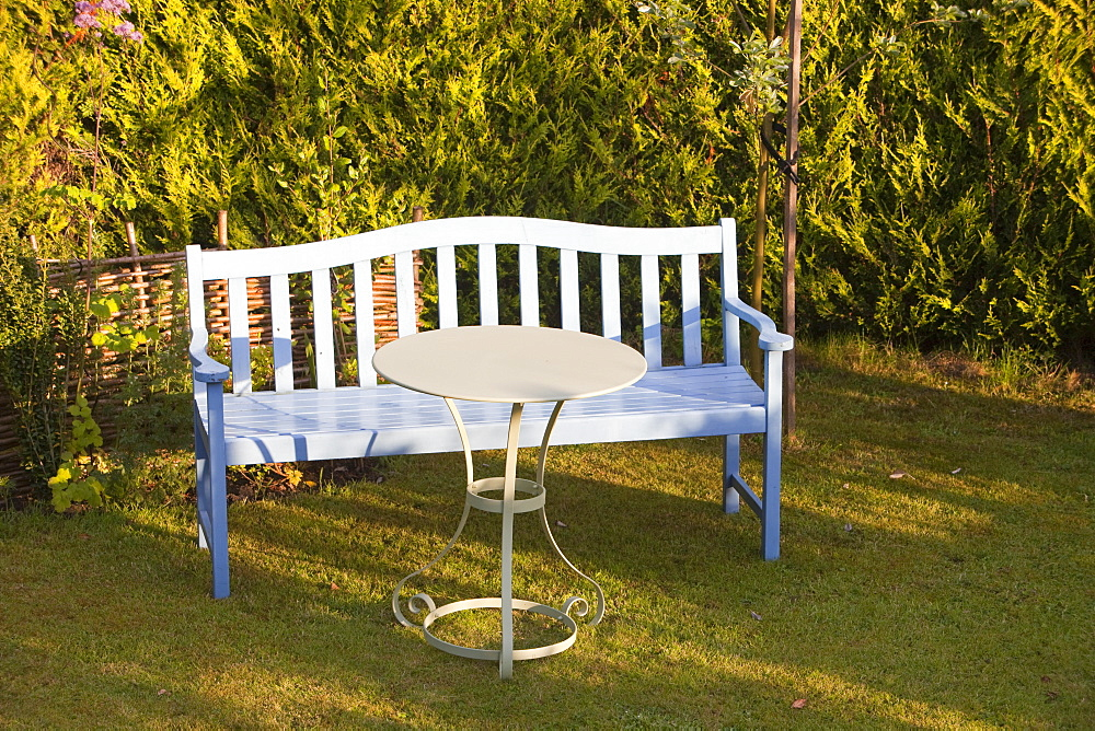 A garden bench and table on a garden lawn, Ambleside, Cumbria, England, United Kingdom, Europe