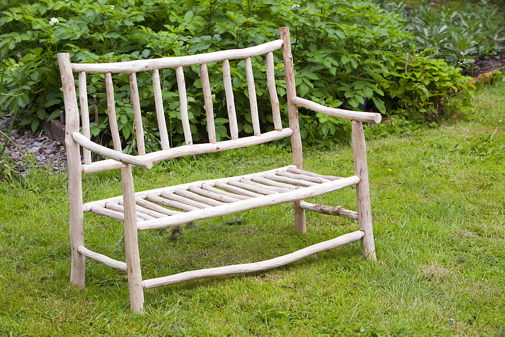 A handmade garden bench in Sprint Mill Garden, near Kendal, Cumbria England, United Kingdom, Europe