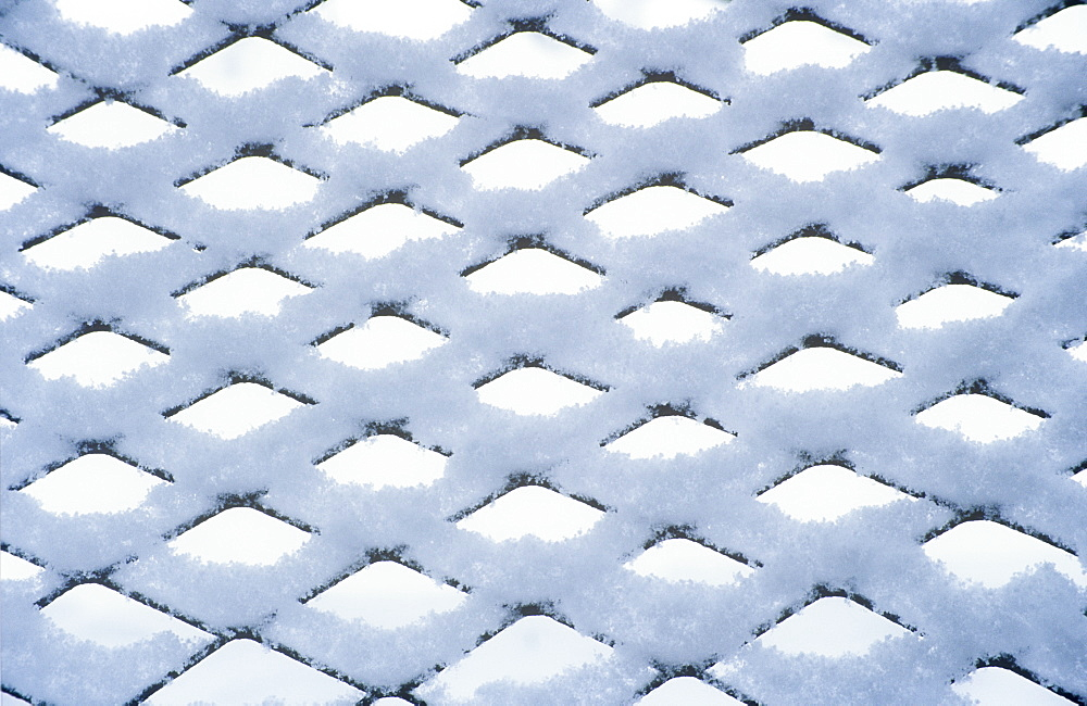 Snow settling on a fence, United Kingdom, Europe
