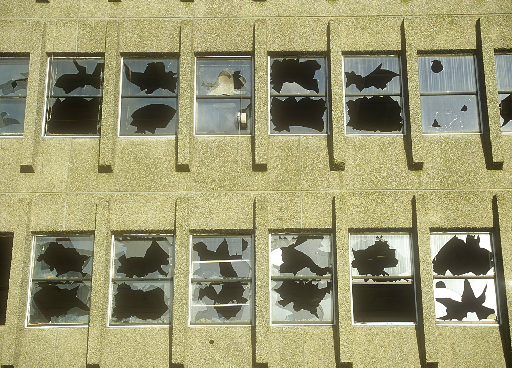 Smashed windows in a derelict building in Oldham, Lancashire, England, United Kingdom, Europe