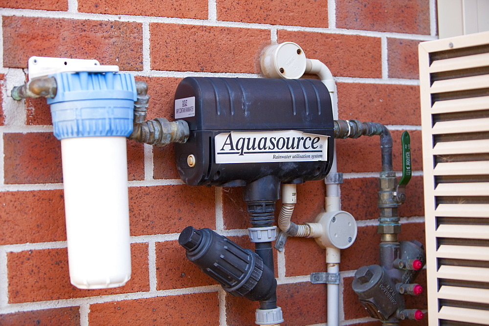 An aquasource pump that pumps rain water collected off the house roof and stored in an underground tank for use in flushing toilets, Sydney, New South Wales, Australia, Pacific