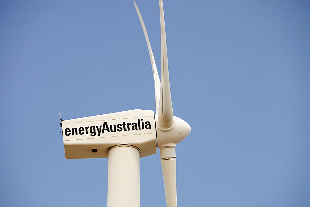A lone wind turbine stands defiant pointing to a more sustainable future, in Newcastle, the world's largest coal port, New South Wales, Australia, Pacific - 911-6053