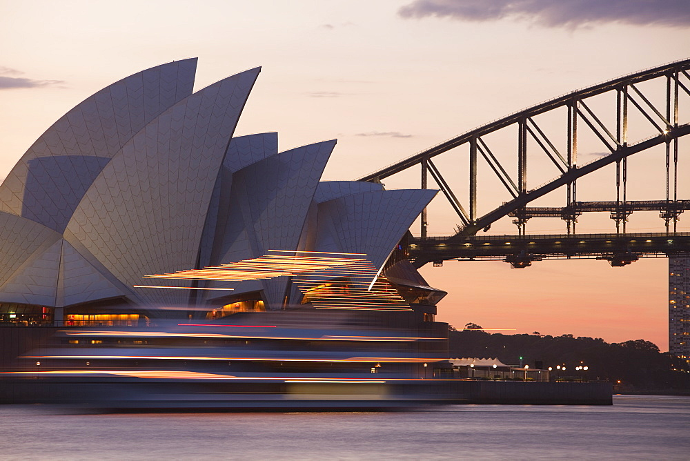 Sydney Opera House, UNESCO World Heritage Site, and Harbour Bridge at sunset, Sydney, New South Wales, Australia, Pacific