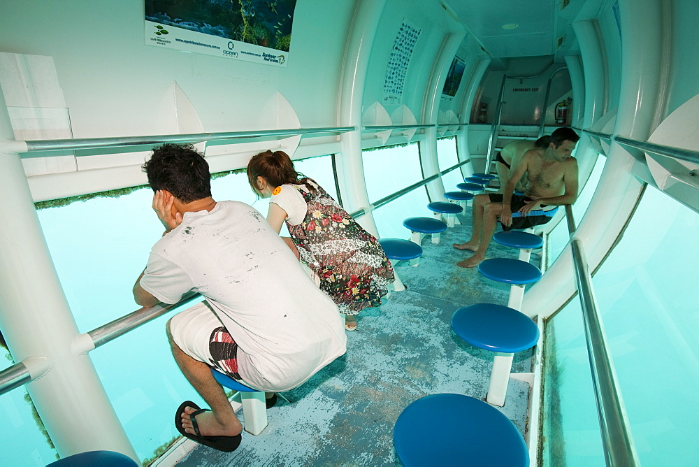 Tourists on a semi submersible, viewing the Great Barrier Reef off Cairns in Queensland, Australia, Pacific