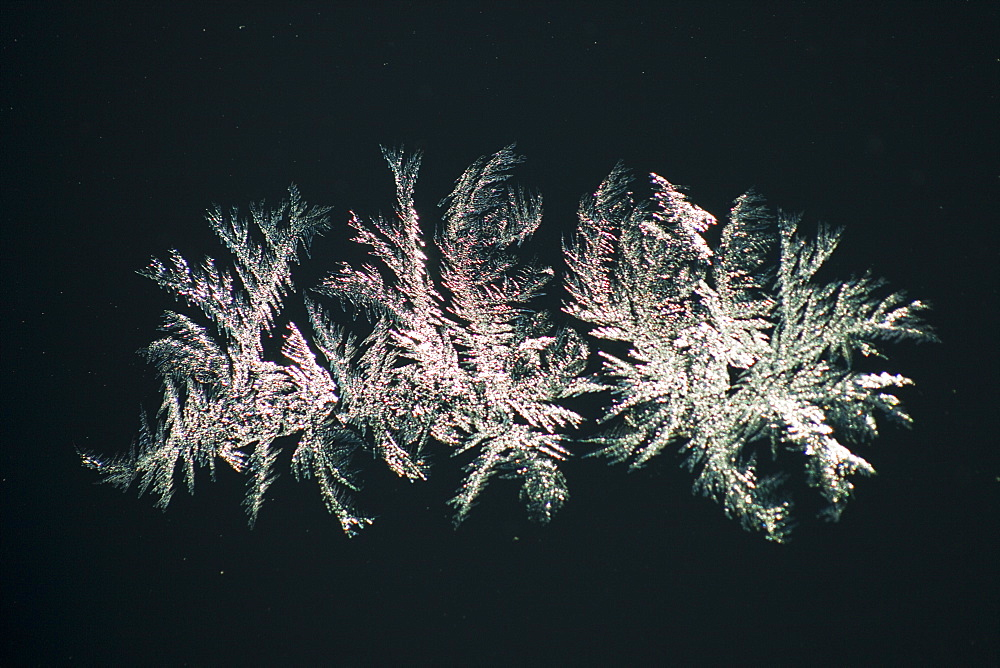 Ice crystals on a car windscreen in cold temperatures