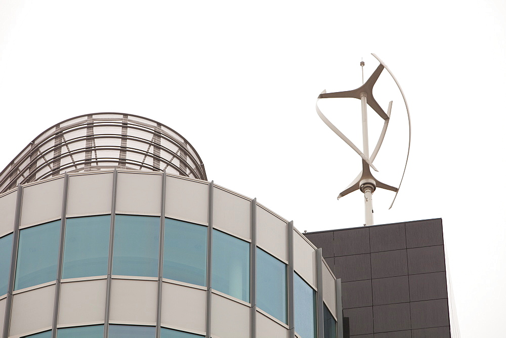 An urban wind turbine on the roof of The Peninsula, a new office development in Manchester, England, United Kingdom, Europe