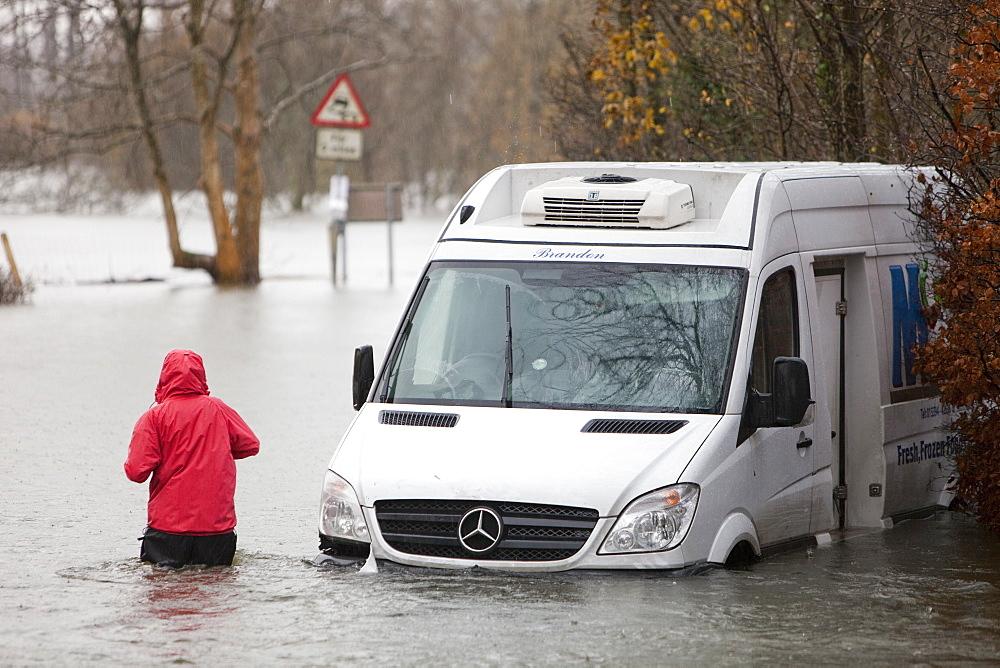 A van washed away on a flooded road near Ambleside, Lake District, Cumbria, England, United Kingdom, Europe