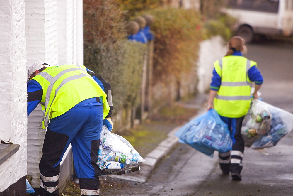 Council workers collecting bags of recycled rubbish in Polruan, Cornwall, England, United Kingdom, Europe
