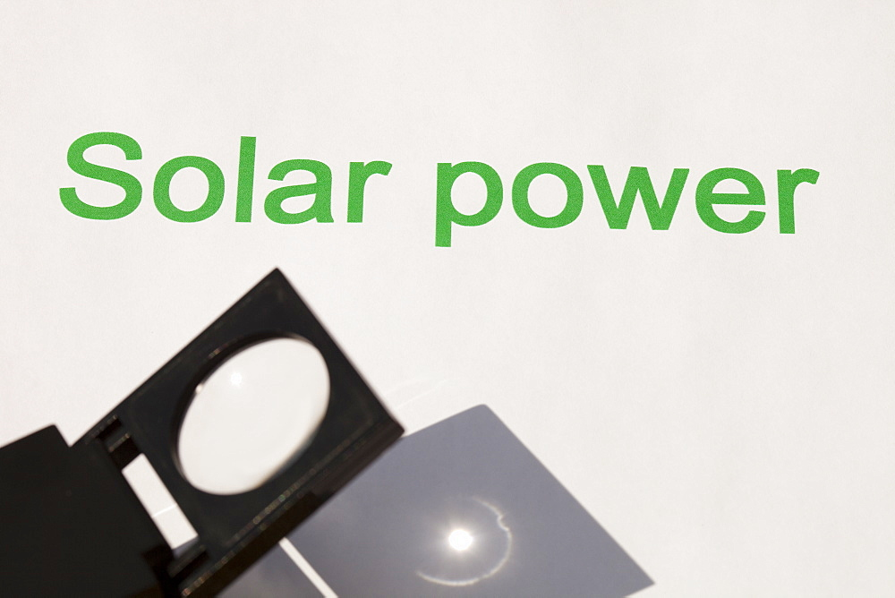 Solar power, concentrating the sun's power through a magnfying glass