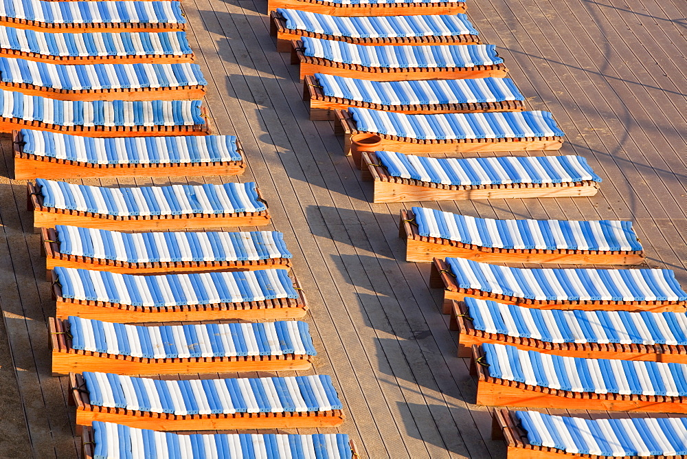 Sunbathing loungers at a holiday resort in Teos, Western Turkey, Eurasia