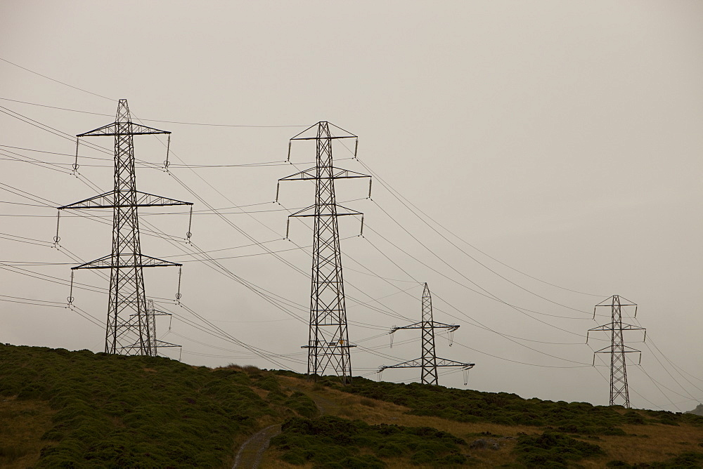 Electricity pylons traversing Bwlch Y Ddeufaen on the edge of the Snowdonia Mountains, North Wales, United Kingdom, Europe
