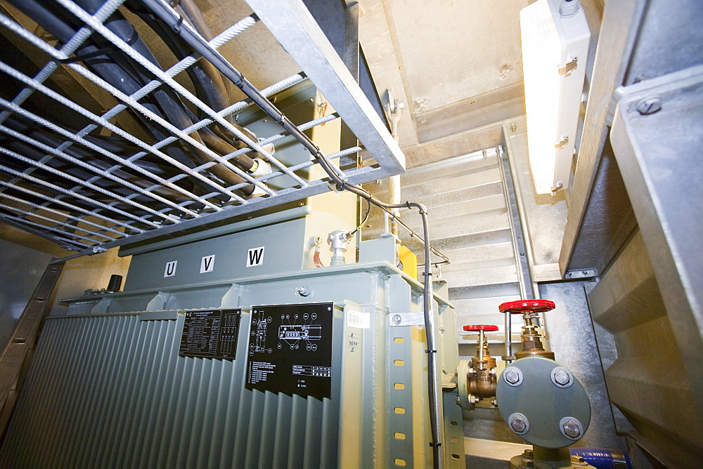 An electrical transformer inside an offshore wind turbine, destined for the Walney offshore wind farm, Mostyn, North Wales, Wales, United Kingdom, Europe