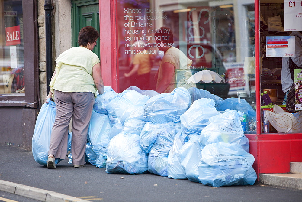 Trade waste bags outside a charity shop in Clitheroe, Lancashire, England, United Kingdom, Europe