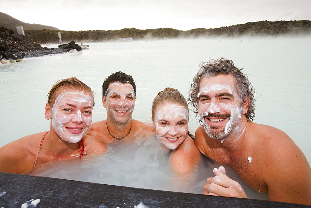 Four friends relax at the Blue Lagoon near at Keflavik in Iceland, Polar Regions