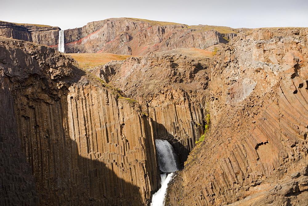 Litlifoss waterfall, below Hengifoss, a waterfall surrounded by columnar jointing in the Basalt rock, near Egilsstadir, Iceland, Polar Regions