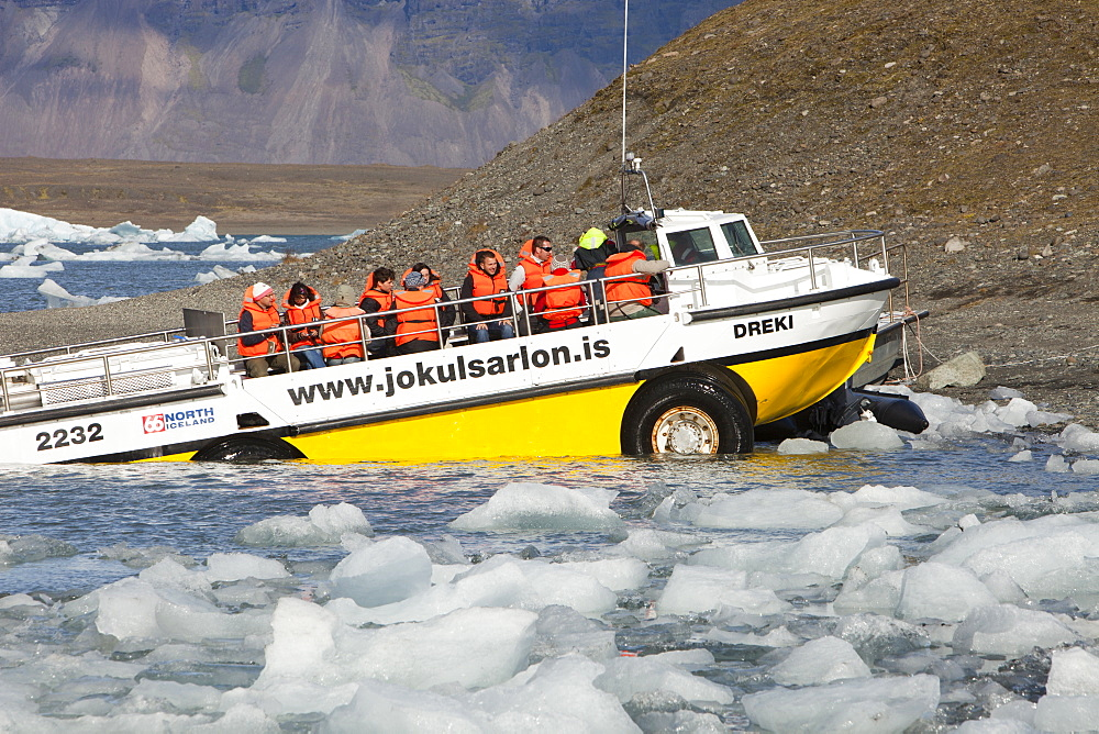 An amphibious vehicle taking tourists on a trip at the Jokulsarlon ice lagoon which is one of the most visited places in Iceland, Polar Regions