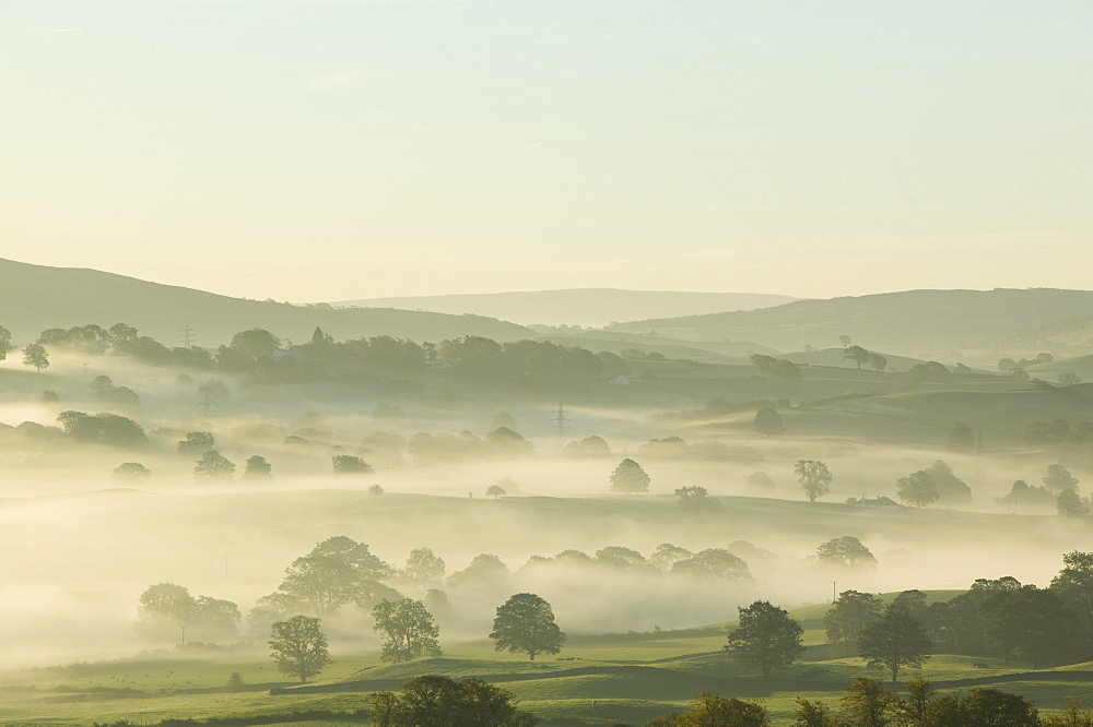 Morning mist over the Kent Valley near Kendal Cumbria UK