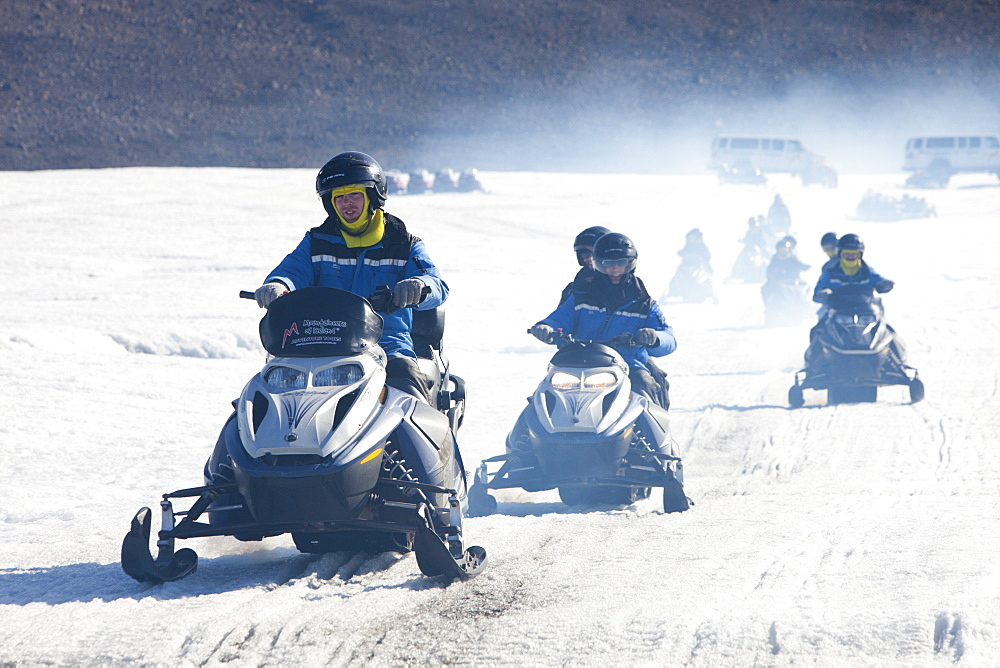 Tourists riding through a stinking fog of exhaust fumes from skidoos on the Langjokull ice sheet in Iceland, Polar Regions