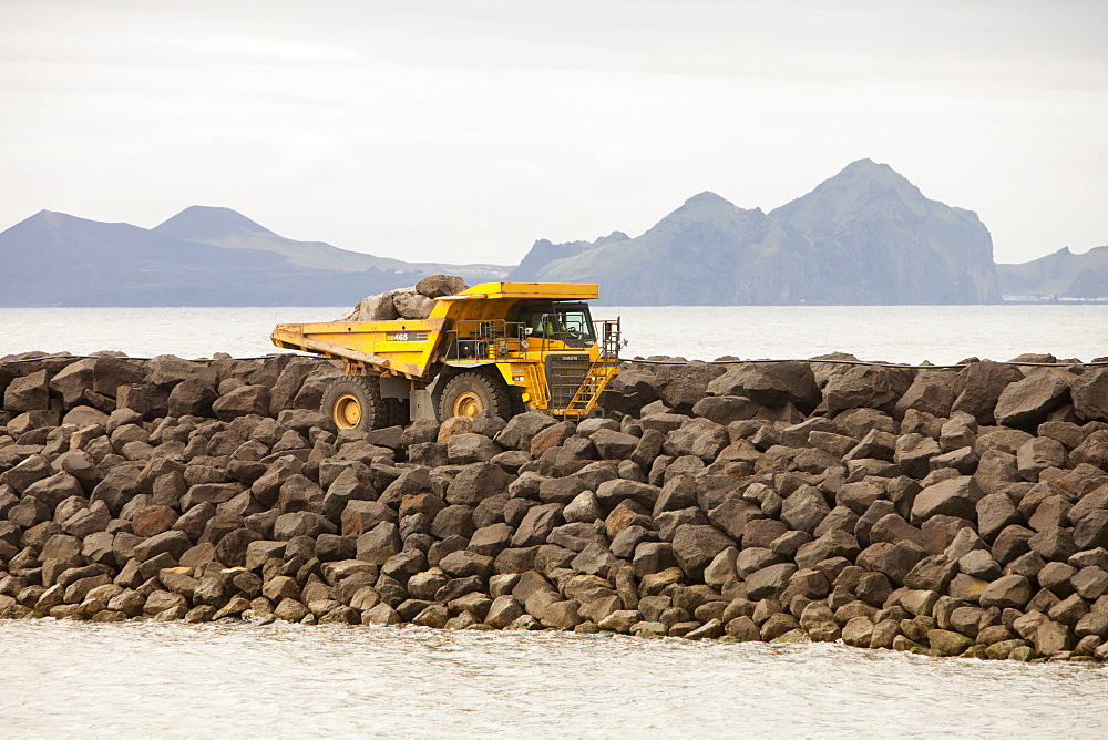 Building a new harbour for the ferry to the Westman Islands, seen in the background, on the south coast, Iceland, Polar Regions
