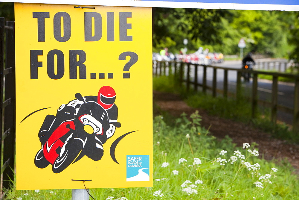 A sign warning motorcyclists of dangerous riding at Devils Bridge in Kirkby Lonsdale, Cumbria, England, United Kingdom, Europe