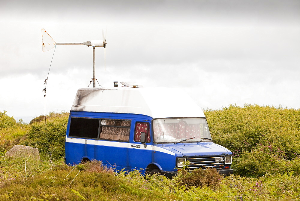 A traveller's camper van with a wind turbine used to power a computer and other electrical equipment near Zennor, Cornwall, England, United Kingdom, Europe