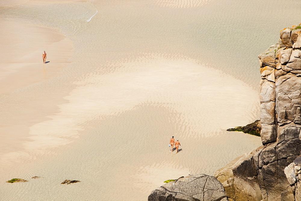 Nude bathers on a nudism beach at Porthcurno, Cornwall England, United Kingdom, Europe