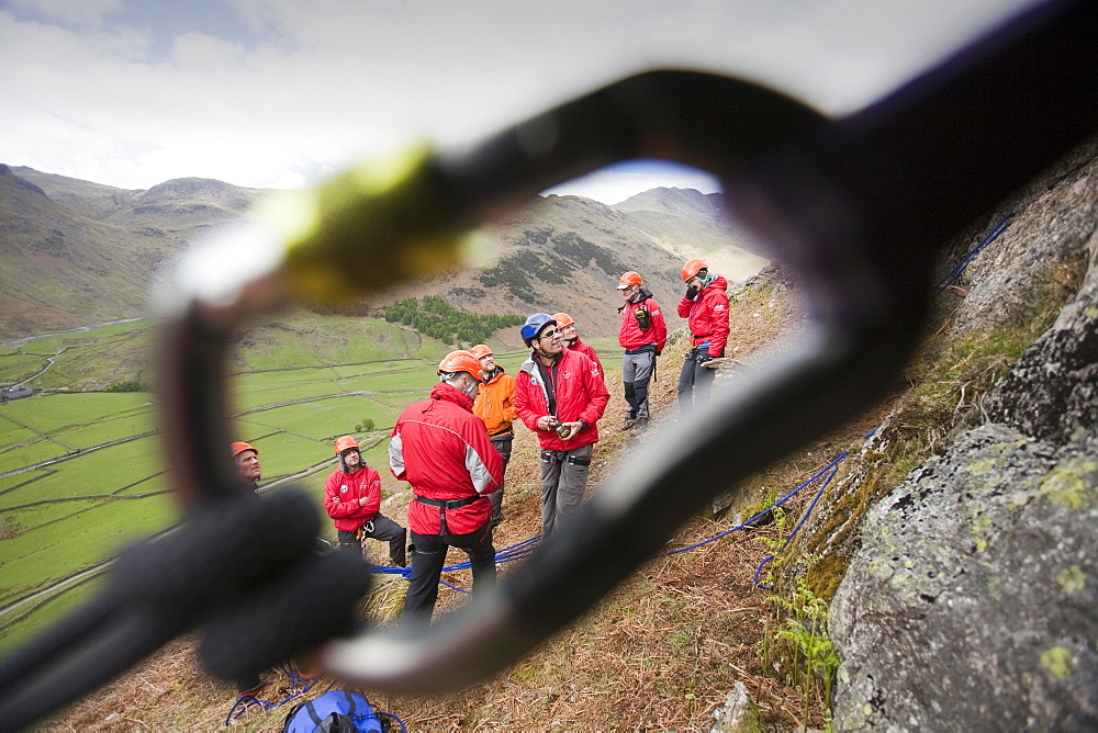 Members of the Langdale/Ambleside mountain Rescue setting up belays on a Team training in the Langdale Valley, Lake District,, United Kingdom.
