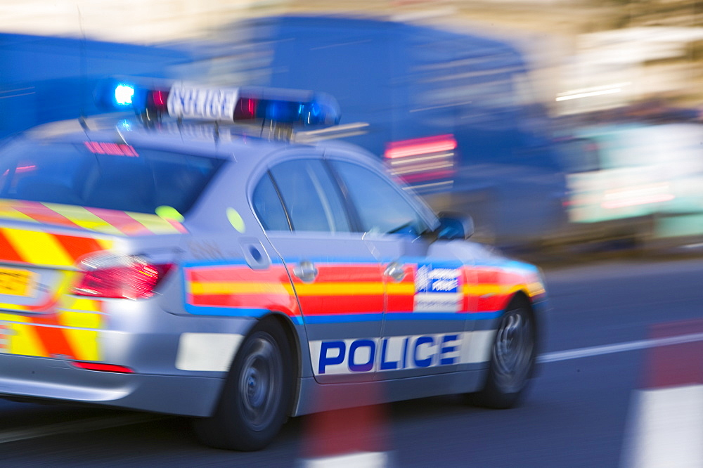 A police car speeding through the streets of London, England, United Kingdom, Europe